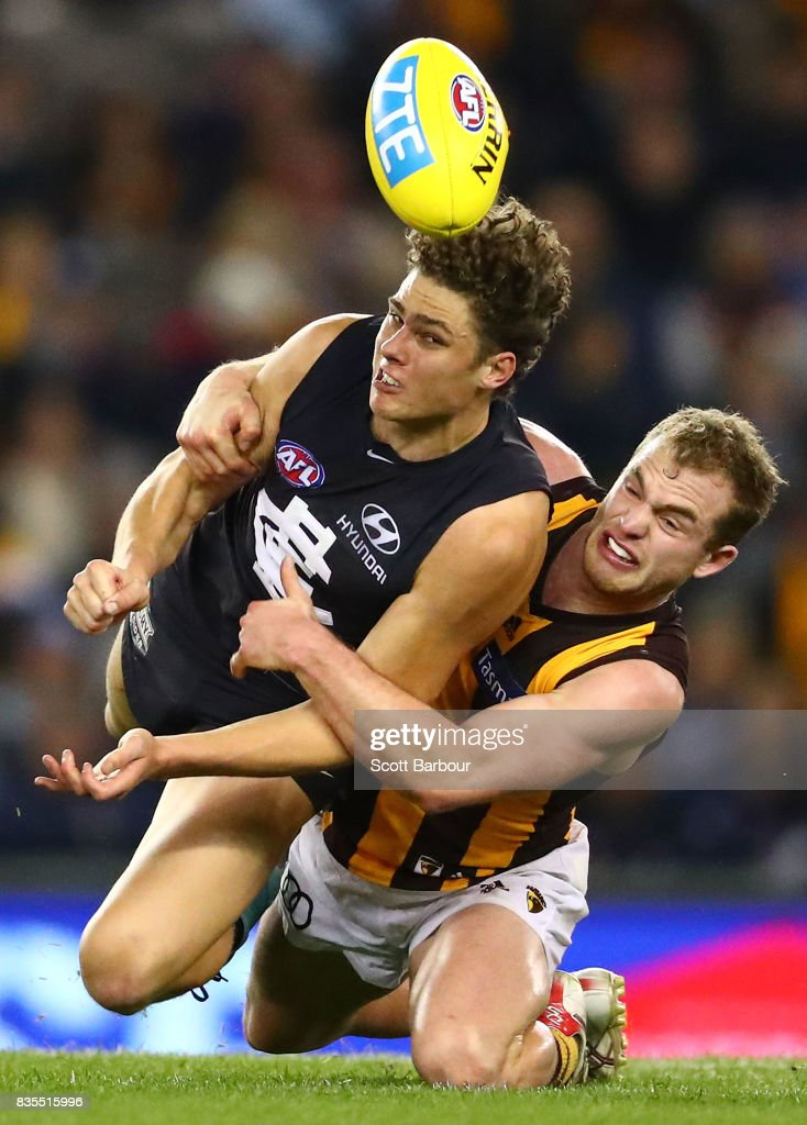 Charlie Curnow of the Blues is tackled by Tom Mitchell of the Hawks during the round 22 AFL match between the Carlton Blues and the Hawthorn Hawks at Etihad Stadium on August 19, 2017 in Melbourne, Australia.