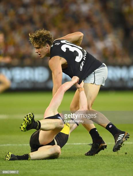 Charlie Curnow of the Blues is tackled during the round one AFL match between the Richmond Tigers and the Carlton Blues at Melbourne Cricket Ground...