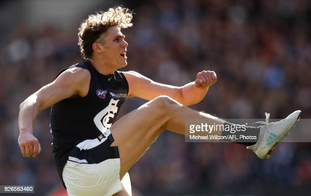 Charlie Curnow of the Blues kicks the ball during the 2017 AFL round 20 match between the Essendon Bombers and the Carlton Blues at the Melbourne...