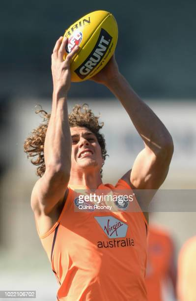 Charlie Curnow of the Blues marks during a Carlton Blues AFL training session at Ikon Park on August 24 2018 in Melbourne Australia