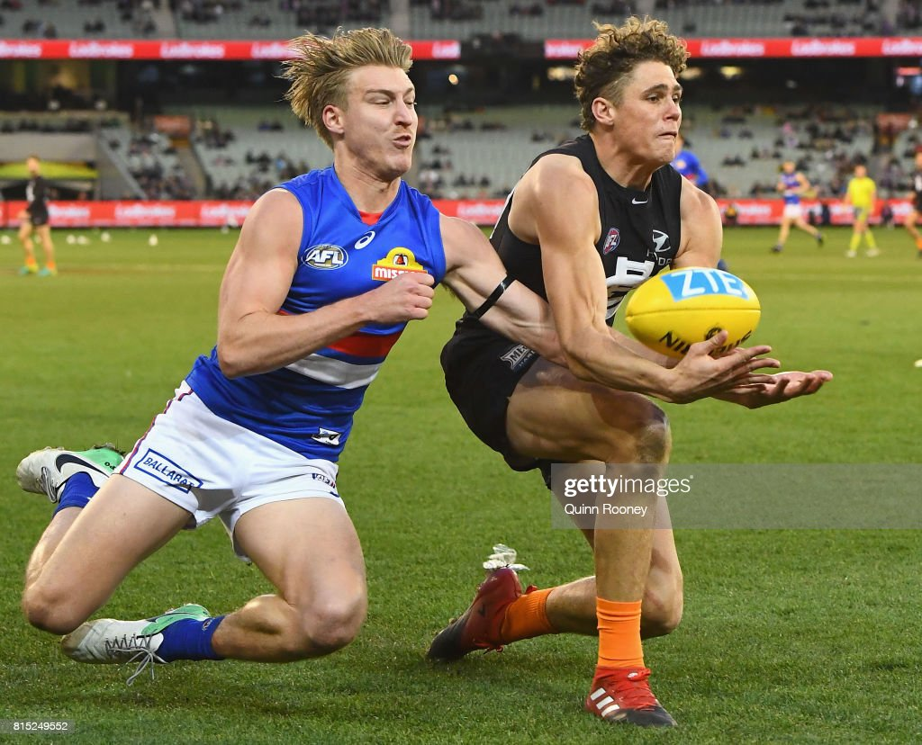 Charlie Curnow of the Blues marks infront of Shane Biggs of the Bulldogs during the round 17 AFL match between the Carlton Blues and the Western Bulldogs at Melbourne Cricket Ground on July 16, 2017 in Melbourne, Australia.
