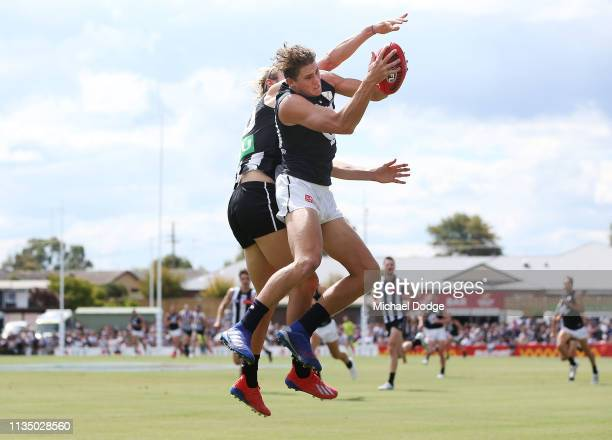 Charlie Curnow of the Blues marks the ball against Darcy Moore of the Magpies during the 2019 JLT Community Series match between the Collingwood...