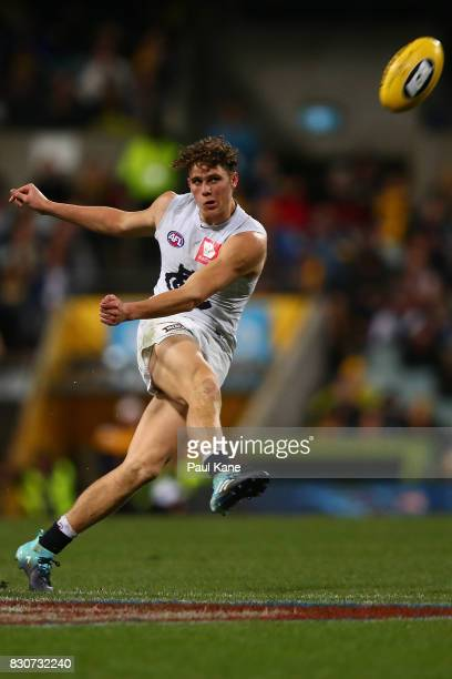 Charlie Curnow of the Blues passes the ball during the round 21 AFL match between the West Coast Eagles and the Carlton Blues at Domain Stadium on...