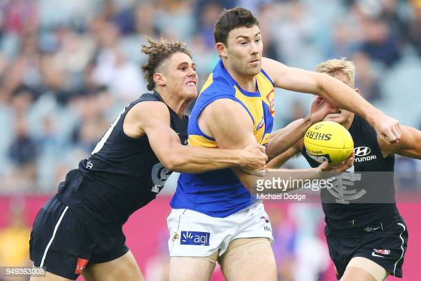 Charlie Curnow of the Blues tackles Jeremy McGovern of the Eagles during the round five AFL match between the Carlton Blues and the West Coast Eagles...