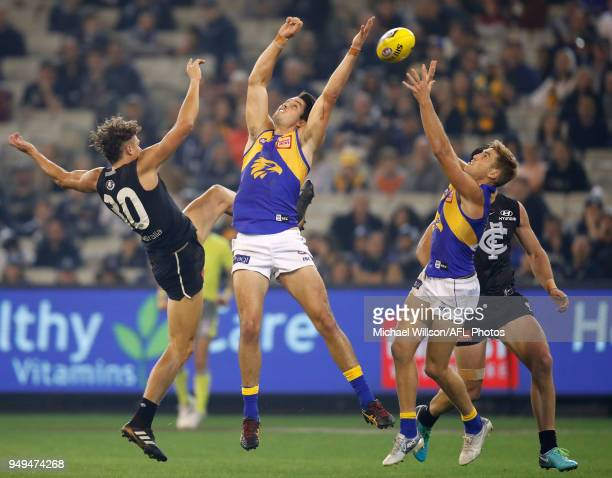 Charlie Curnow of the Blues Tom Barrass of the Eagles and Brad Sheppard of the Eagles compete for the ball during the 2018 AFL round five match...