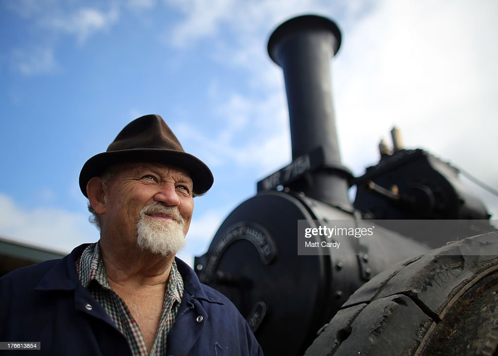 Charlie Daniel stands besides his 1918 Fowler steam engine that he is preparing to show at the Cornish Steam and Country Fair at the Stithians Showground on August 16, 2013 near Penryn, England. The annual show, now in 58th year, is one of Cornwall's largest outdoor events and is one of the UK's most popular and respected steam rallies.