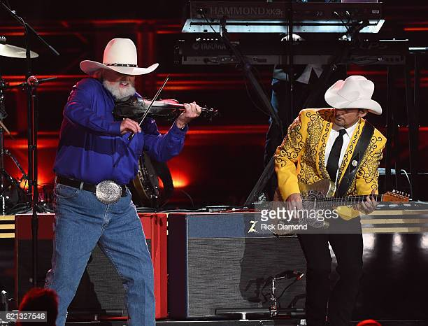 Charlie Daniels and Brad Paisley perform during the 50th annual CMA Awards at the Bridgestone Arena on November 2 2016 in Nashville Tennessee