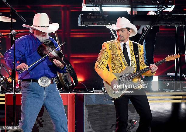 Charlie Daniels and Brad Paisley perform onstage at the 50th annual CMA Awards at the Bridgestone Arena on November 2 2016 in Nashville Tennessee