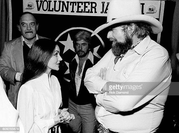 Charlie Daniels chats backstage with Crystal Gayle during Charlie Daniels Volunteer Jam VIII in Nashville Tennessee on January 30 1982