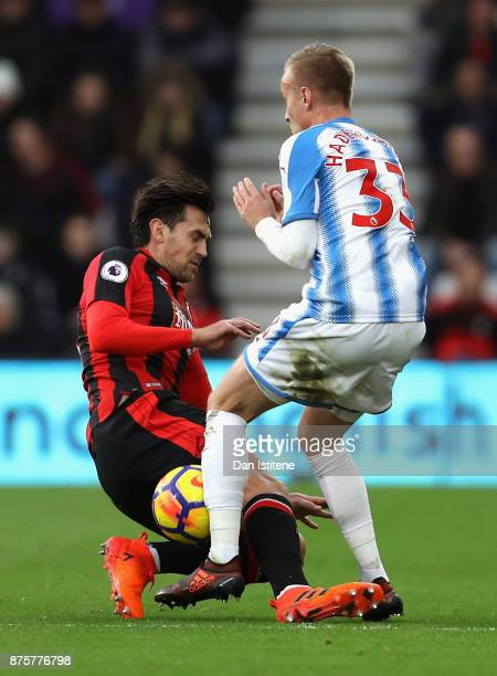 Charlie Daniels of AFC Bournemouth and Florent Hadergjonaj of Huddersfield Town compete for the ball during the Premier League match between AFC...
