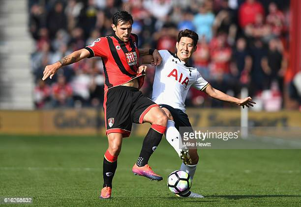 Charlie Daniels of AFC Bournemouth and HeungMin Son of Tottenham Hotspur compete for the ball during the Premier League match between AFC Bournemouth...