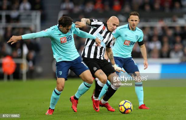 Charlie Daniels of AFC Bournemouth and Jonjo Shelvey of Newcastle United battle for possession during the Premier League match between Newcastle...