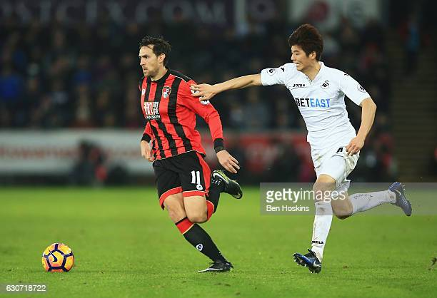 Charlie Daniels of AFC Bournemouth and Ki SungYueng of Swansea City compete for the ball during the Premier League match between Swansea City and AFC...