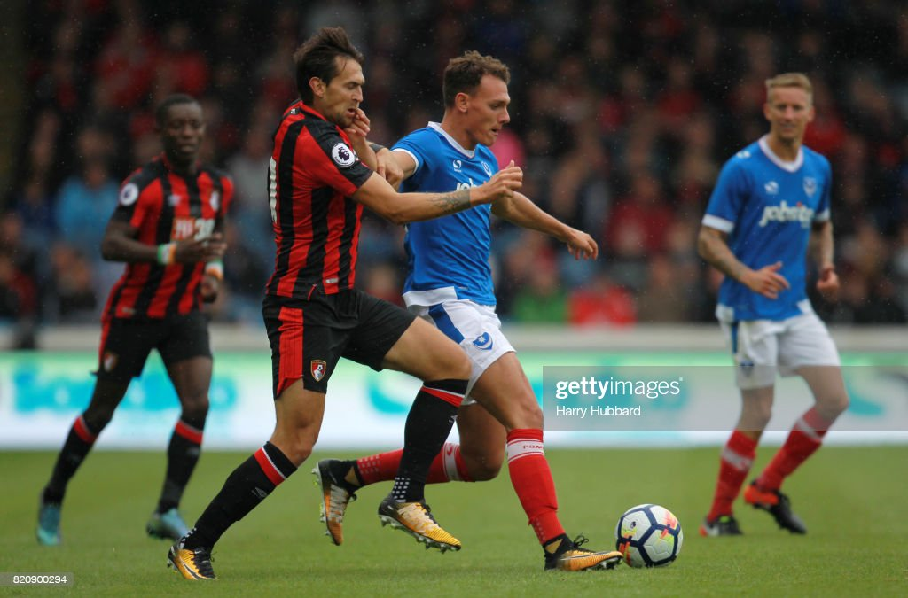 Charlie Daniels of AFC Bournemouth and Matt Worthington of Portsmouth in action during a pre-season friendly match between Portsmouth and AFC Bournemouth at Fratton Park on July 22, 2017 in Portsmouth, England.