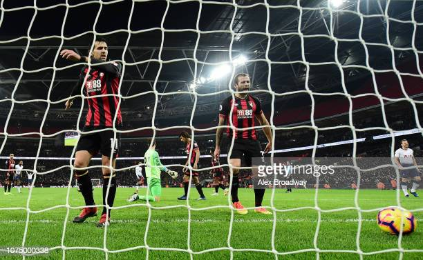 Charlie Daniels of AFC Bournemouth and Steve Cook of AFC Bournemouth react after Tottenham Hotspur score their 5th goal during the Premier League...