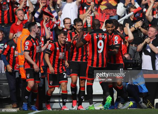 Charlie Daniels of AFC Bournemouth celebrates scoring his sides fourth goal with team mates during the Premier League match between AFC Bournemouth...