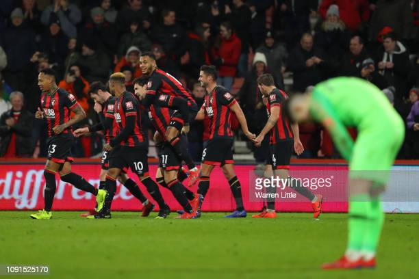 Charlie Daniels of AFC Bournemouth celebrates with teammates after scoring his team's fourth goal during the Premier League match between AFC...