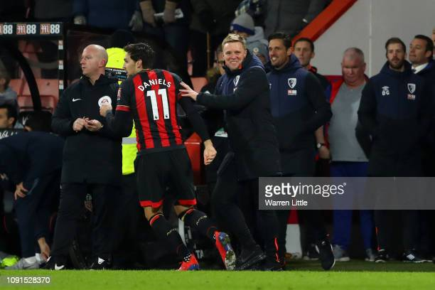 Charlie Daniels of AFC Bournemouth is congratulated by Eddie Howe, Manager of AFC Bournemouth after scoring his team's fourth goal during the Premier...