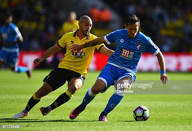 Charlie Daniels of AFC Bournemouth is put under pressure from Nordin Amrabat of Watford during the Premier League match between Watford and AFC...