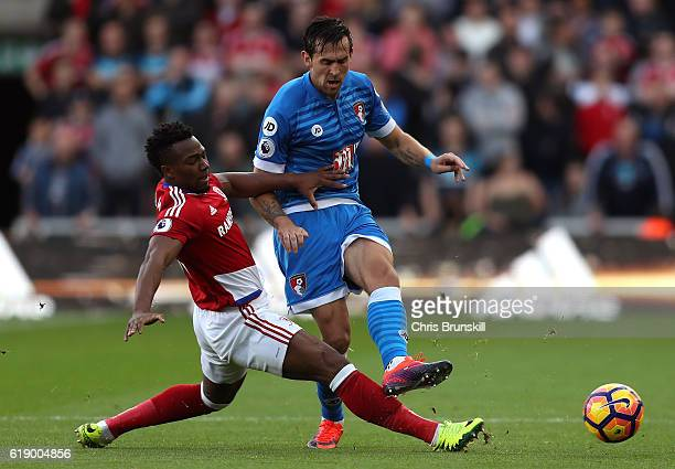 Charlie Daniels of AFC Bournemouth is tackled by Adama Traore of Middlesbrough during the Premier League match between Middlesbrough and AFC...