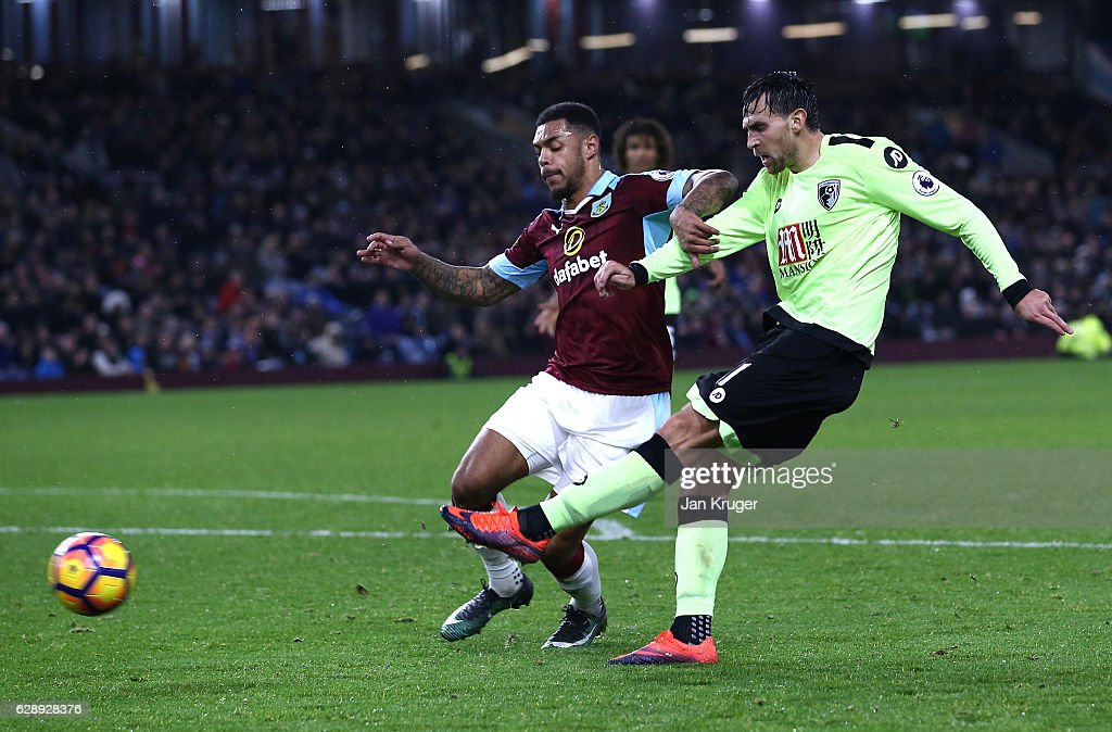 Charlie Daniels of AFC Bournemouth (R) scores his sides second goal during the Premier League match between Burnley and AFC Bournemouth at Turf Moor on December 10, 2016 in Burnley, England.