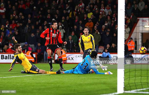 Charlie Daniels of AFC Bournemouth scores the opening goal past Petr Cech of Arsenal during the Premier League match between AFC Bournemouth and...