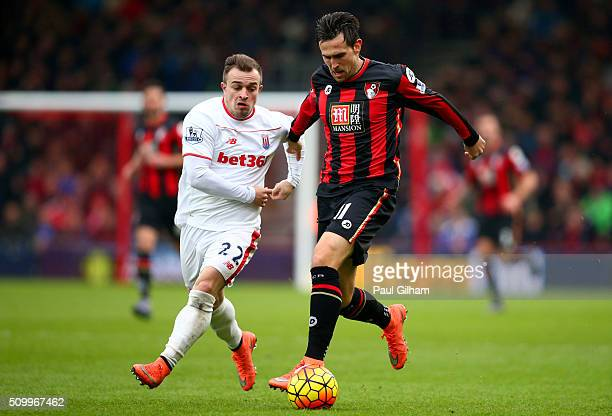 Charlie Daniels of Bournemouth and Xherdan Shaqiri of Stoke City compete for the ball during the Barclays Premier League match between AFC...