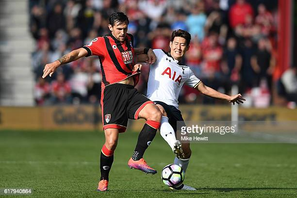 Charlie Daniels of Bournemouth battles with HeungMin Son of Tottenham during the Premier League match between AFC Bournemouth and Tottenham Hotspur...