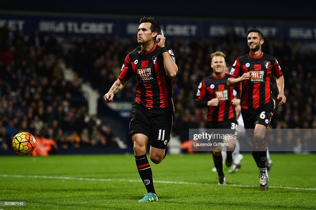 Charlie Daniels (L) of Bournemouth celebrates scoring his team's second goal from the penalty spot during the Barclays Premier League match between West Bromwich Albion and A.F.C. Bournemouth at The Hawthorns on December 19, 2015 in West Bromwich, England.
