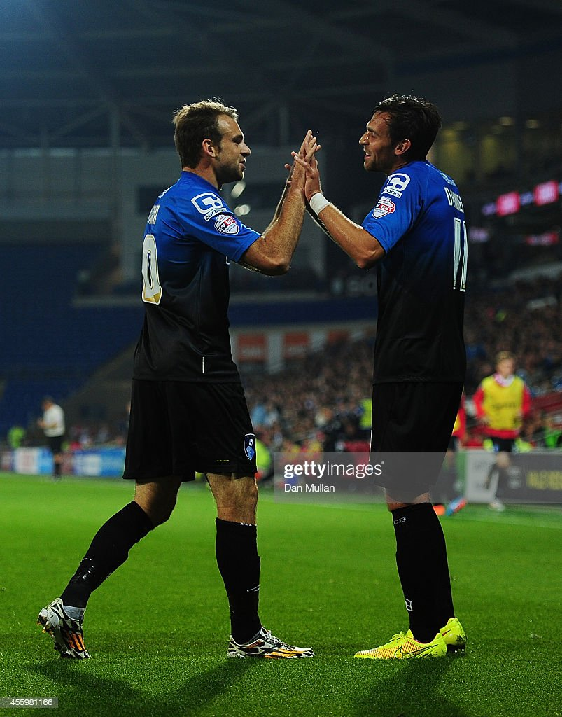 Charlie Daniels of Bournemouth (R) celebrates with Brett Pitman of Bournemouth after scoring his side's second goal during the Capital One Cup third round match between Cardiff City and Bournemouth at Cardiff City Stadium on September 23, 2014 in Cardiff, Wales.