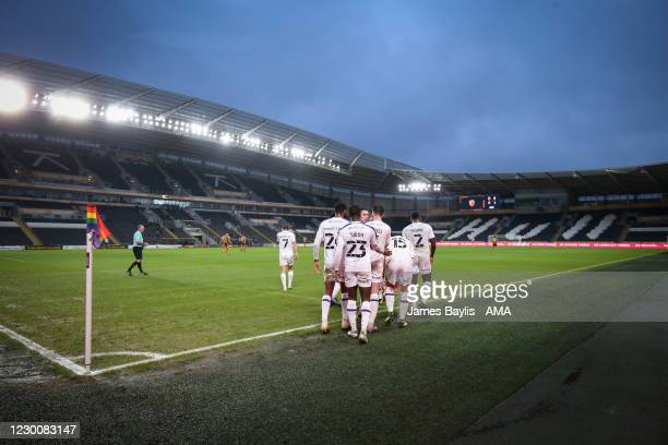 Charlie Daniels of Shrewsbury Town celebrates with his team mates after scoring a goal to make it 0-1 during the Sky Bet League One match between...