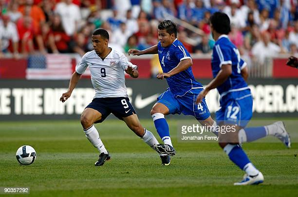 Charlie Davies of the United States battles Mardoqueo Henriquez of El Salvadorduring the FIFA 2010 World Cup Qualifier match between the United...