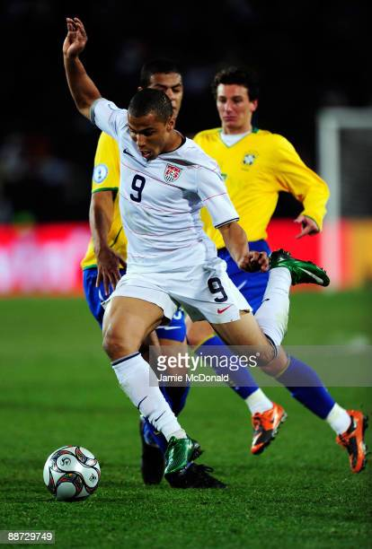 Charlie Davies of USA breaks through the Brazil defence during the FIFA Confederations Cup Final between USA and Brazil at the Ellis Park Stadium on...