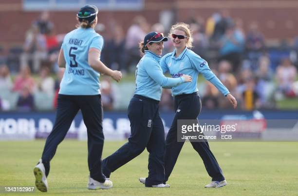 Charlie Dean, Tammy Beaumont and Heather Knight of England celebrate victory after the 5th One Day International match between England and New...