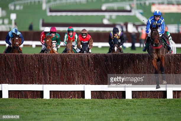 Charlie Deutsch riding Aachen lead all the way to win The Ryman Stationary Handicap Steeple Chase at Cheltenham racecourse on December 11 2015 in...