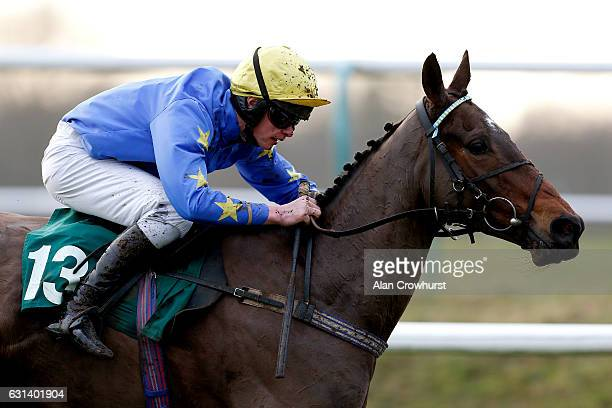 Charlie Deutsch riding Burgess Dream clear the last to win The Racing Welfare Handicap Hurdle Race at Lingfield Park on January 10 2017 in Lingfield...
