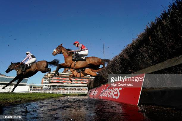 Charlie Deutsch riding Fanion D'Estruval clear the water jump before going on to win The Ladbrokes Chase at Newbury Racecourse on November 29, 2019...