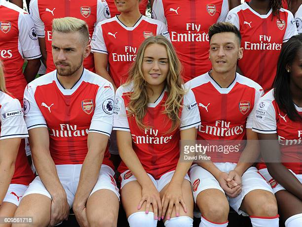 Charlie Devlin of Arsenal Ladies sits with Aaron Ramsey and Mesut Ozil of Arsenal during the Arsenal Squad photos at London Colney on September 21...