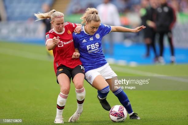 Charlie Devlin of Leicester City Women in action with Jackie Groenen of Manchester United Women during the Barclays FA Women's Super League match...