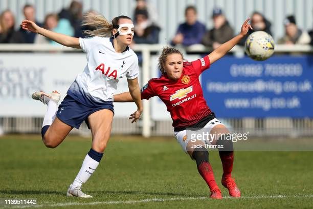 Charlie Devlin of Manchester United Women is challenged by Josie Green of Tottenham Ladies during the WSL 2 match between Tottenham Hotspur Women and...