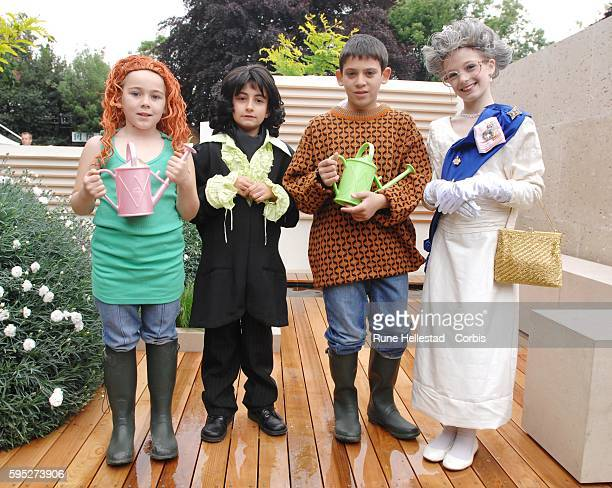 Charlie DimmockLawrence LlwellynBowenHM Queen Elizabeth II and Alan Titschmarch lookalikes attend the Chelsea Flower Show