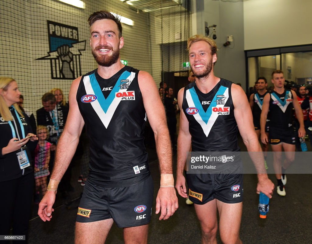 Charlie Dixon and Jack Hombsch of the Power react after the round two AFL match between the Port Adelaide Power and the Fremantle Dockers at Adelaide Oval on April 2, 2017 in Adelaide, Australia.