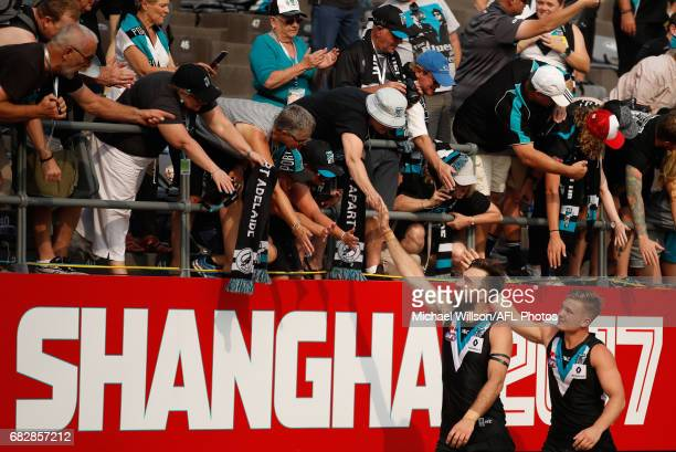 Charlie Dixon and Ollie Wines of the Power celebrate during the 2017 AFL round 08 match between the Gold Coast Suns and Port Adelaide Power at...