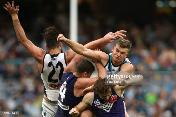 Charlie Dixon and Ollie Wines of the Power contest for the ball against Sean Darcy and Joel Hamling of the Dockers during the round 17 AFL match...