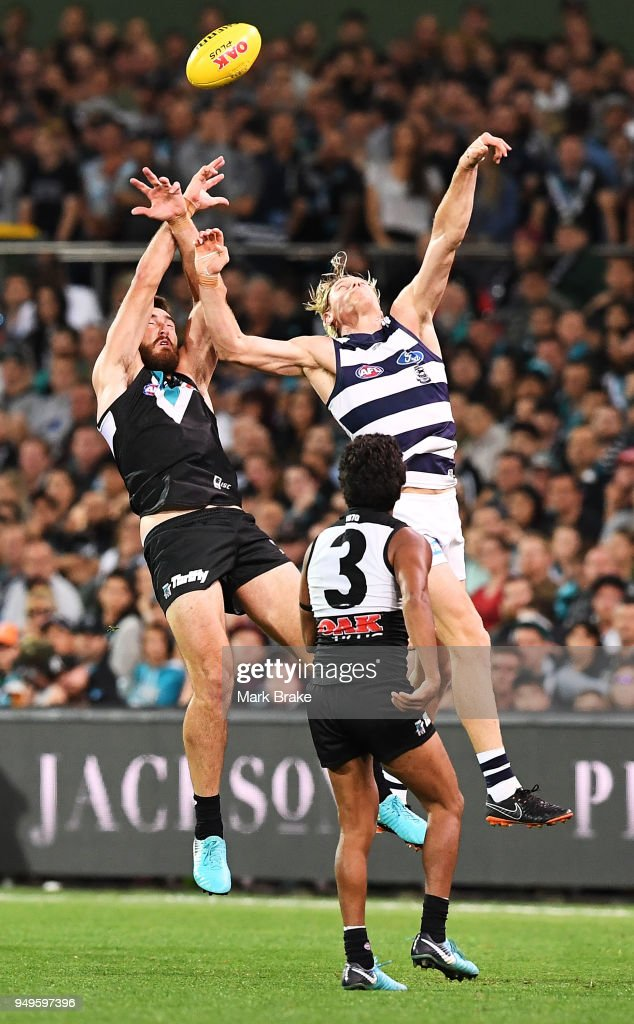 Charlie Dixon of Port Adelaide taps towards Jake Neade of Port Adelaide during the round five AFL match between the Port Adelaide Power and the Geelong Cats at Adelaide Oval on April 21, 2018 in Adelaide, Australia.