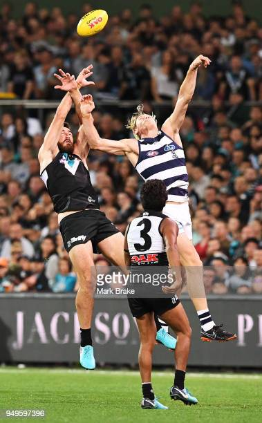 Charlie Dixon of Port Adelaide taps towards Jake Neade of Port Adelaide during the round five AFL match between the Port Adelaide Power and the...