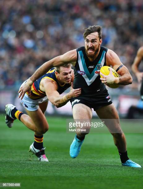Charlie Dixon of Port Adelaide under pressure from Daniel Talia of the Adelaide Crows during the round eight AFL match between the Port Adelaide...
