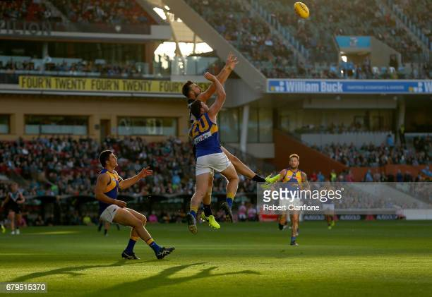 Charlie Dixon of the Power and Jeremy McGovern of the Eagles compete for the ball during the round seven AFL match between the Port Adelaide Power...