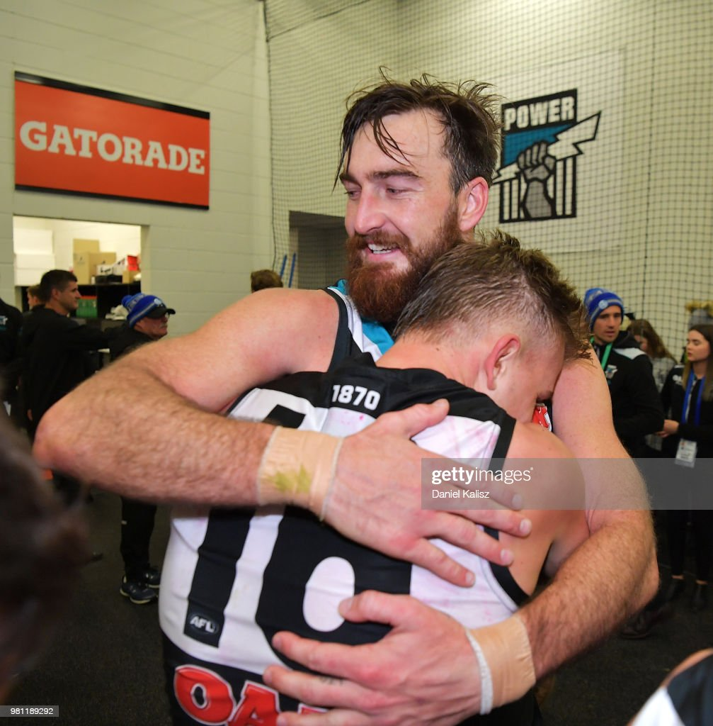 Charlie Dixon of the Power and Ollie Wines of the Power celebrate after the round 14 AFL match between the Port Adelaide Power and the Melbourne Demons at Adelaide Oval on June 22, 2018 in Adelaide, Australia.