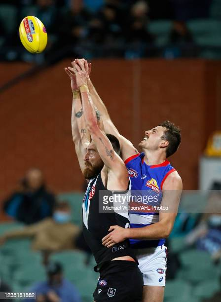 Charlie Dixon of the Power and Zaine Cordy of the Bulldogs compete for the ball during the 2021 AFL Second Preliminary Final match between the Port...